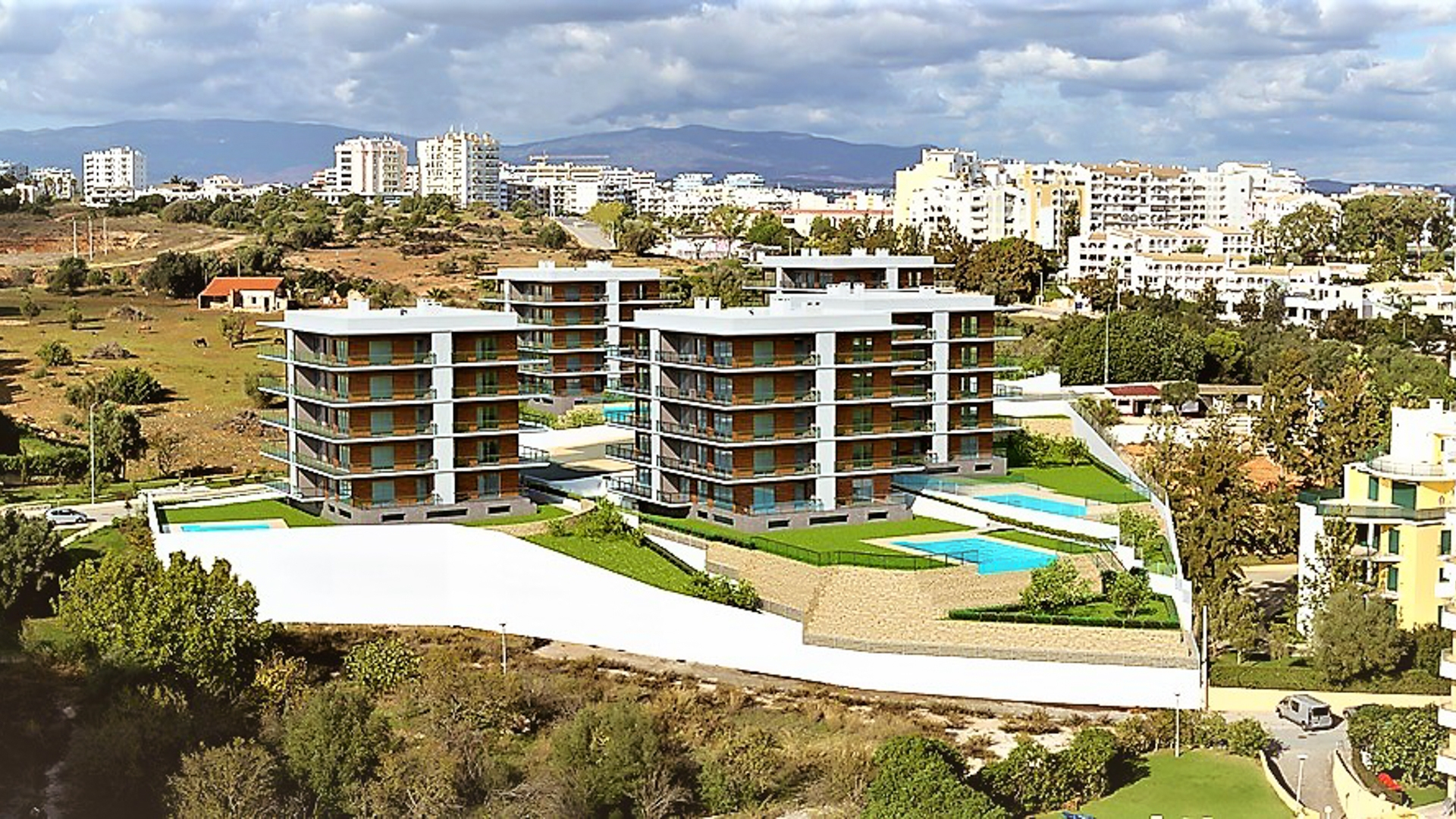 Off plan - Modern one bedroom apartments with partial sea views in Praia da Rocha, Portimão | LG1427 Small closed condominium with private underground parking and private swimming pool. Located a short walk from the beach, in Portimão. Fully equipped and modern with south facing views towards the sea.