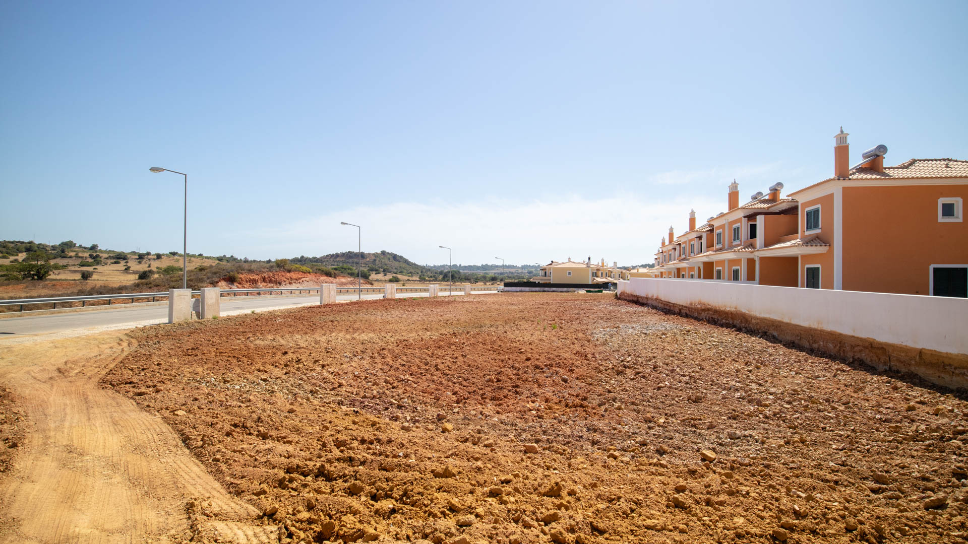 Investment Opportunity: Plot with Building Permission on Urbanization near Guia, Albufeira | VM1517 Flat plot on in an urbanisation with permission to build already in place for 10 linked villas. All infrastructure is present for utilities.
